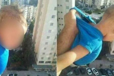 Bebeğini 15. kattan sarkıtan baba: Bin beğeni alamazsam atarım